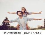 cute romantic bearded brunet in ... | Shutterstock . vector #1034777653
