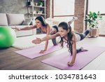 Stock photo vitality concept watch repeat the moves poses from the helpful video cute sweet cheerful joyful 1034781643