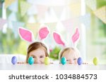 two cute little sisters wearing ... | Shutterstock . vector #1034884573