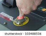 Male hand pushing emergency stop button. - stock photo