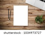 top view of blank paper page on ... | Shutterstock . vector #1034973727