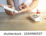 close up of asian woman hands... | Shutterstock . vector #1034980537