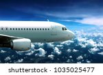 airplane flying in cloudy sky... | Shutterstock . vector #1035025477