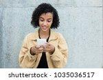 latin american woman sending... | Shutterstock . vector #1035036517