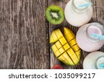 smoothies with tropical fruits... | Shutterstock . vector #1035099217