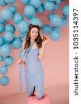a tender girl in a blue dress ...   Shutterstock . vector #1035114397