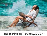 woman working with laptop by... | Shutterstock . vector #1035123067