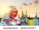 worker arc welding steel pipe... | Shutterstock . vector #1035125377