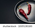 dried red hot chili or chilli... | Shutterstock . vector #1035130183