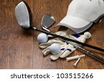 golf equipment on wooden table - stock photo