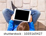 tablet computer in the hands of ...   Shutterstock . vector #1035165427