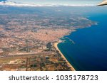 etna volcano from the airplane... | Shutterstock . vector #1035178723