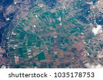 green agro fields from airplane ... | Shutterstock . vector #1035178753
