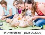 group of cheerful women... | Shutterstock . vector #1035202303