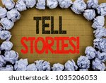 Small photo of Tell Stories. Business concept for Storytelling Telling Story written on vintage background with space on old background with folded paper balls