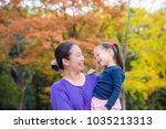 asian woman holding her... | Shutterstock . vector #1035213313