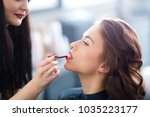 make up artist working on client   Shutterstock . vector #1035223177