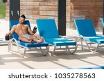 young man resting on sun... | Shutterstock . vector #1035278563