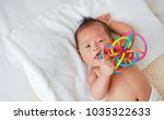 asian infant baby boy lying on... | Shutterstock . vector #1035322633