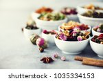 assortment of dry tea in white... | Shutterstock . vector #1035334153