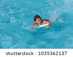 happy little girl bathes in the ... | Shutterstock . vector #1035362137