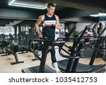 athletic man running in a...   Shutterstock . vector #1035412753