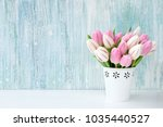 pink tulips bouquet in white...   Shutterstock . vector #1035440527
