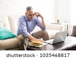 busy mature hispanic man...   Shutterstock . vector #1035468817