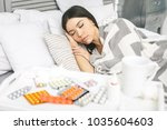 sick woman lying in bed with... | Shutterstock . vector #1035604603