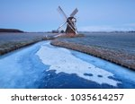 dutch windmill in dusk by...   Shutterstock . vector #1035614257
