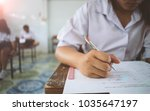 students writing pen in hand... | Shutterstock . vector #1035647197
