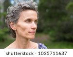profile of middle aged woman... | Shutterstock . vector #1035711637