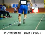 Small photo of Sportsman starting acceleration in long jump competition. Track and field competitions concept background