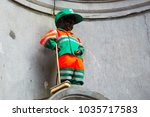 Small photo of Brussels, Belgium - April 22, 2017: Manneken Pis - Little man Pee or le Petit Julien, a landmark small bronze sculpture in Brussels, Belgium