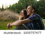 two friends having fun in the... | Shutterstock . vector #1035757477