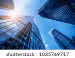 skyscrapers from a low angle... | Shutterstock . vector #1035769717
