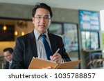asian businessman holding a... | Shutterstock . vector #1035788857