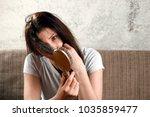 young  beautiful girl is... | Shutterstock . vector #1035859477