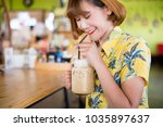 young asian woman drinking ice... | Shutterstock . vector #1035897637