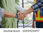 midsection of team of engineer... | Shutterstock . vector #1035923497