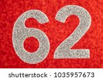 Small photo of Number sixty-two silver color over a red background. Anniversary. Horizontal