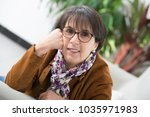 a charming mature woman with... | Shutterstock . vector #1035971983
