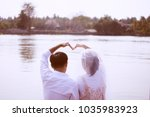 couple love show hand to heart... | Shutterstock . vector #1035983923
