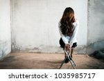 back view of hostage woman with ... | Shutterstock . vector #1035985717