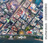 Small photo of Top view aerial photo from flying drone of a Ho Chi Minh City with development buildings, transportation, energy power infrastructure. Financial and business centers in developed Vietnam.