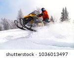 Athlete On A Snowmobile Moving...