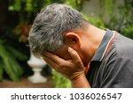 asian old man feeling sad ... | Shutterstock . vector #1036026547