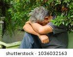 asian old man feeling sad ... | Shutterstock . vector #1036032163
