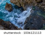 rocks by the sea with waves of... | Shutterstock . vector #1036121113
