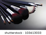 make up brushes on grey... | Shutterstock . vector #103613033